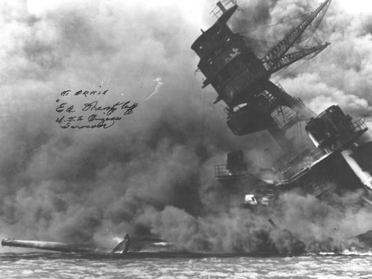 A U.S. Navy photo shows the USS Arizona burning after
