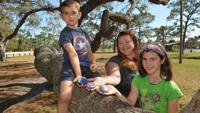 Brevard Rocks is a pay-it-forward group whose Facebook page has over 1,000 members.The idea is for members to paint rocks, and place them around town, for other members to find. In these photos are Jennifer Justiniano and her daughter Aubrey, 11, and son Liam, 5, at Wickham Park, Melbourne.