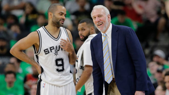 San Antonio Spurs guard Tony Parker (9) talks with San Antonio Spurs head coach Gregg Popovich.