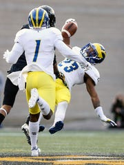 Delaware's Nasir Adderley comes down with a one-handed interception at Towson.