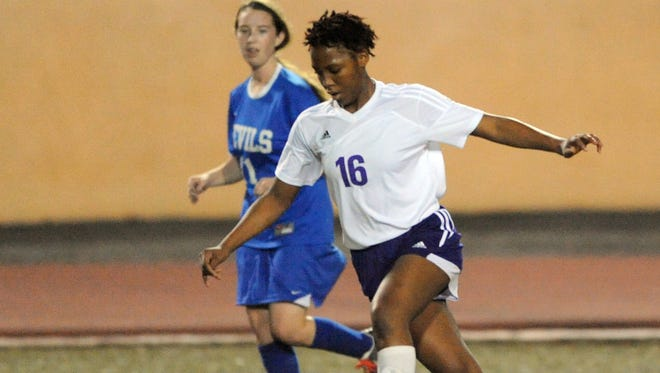 Hattiesburg High senior Essence Barlow kicks the ball in a home game against Pearl River Central on Tuesday.