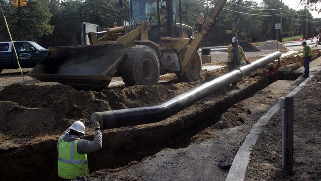 New Jersey Natural Gas workers install pipelines along Lake Road in Manchester in this 2009 file photo.