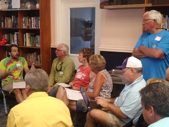 Residents of San Carlos Island gather at a meeting