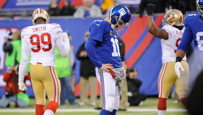 Giants quarterback Eli Manning reacts after failing to score on fourth down during the second half against the San Francisco 49ers on Sunday in East Rutherford, New Jersey.