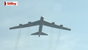 A B-52 Stratofortress flies over the Air Force Memorial