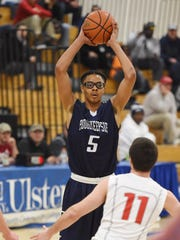 In this Feb. 17, 2016 file photo, Poughkeepsie High School's Caval Haylett looks for a teammate in a game against Red Hook.