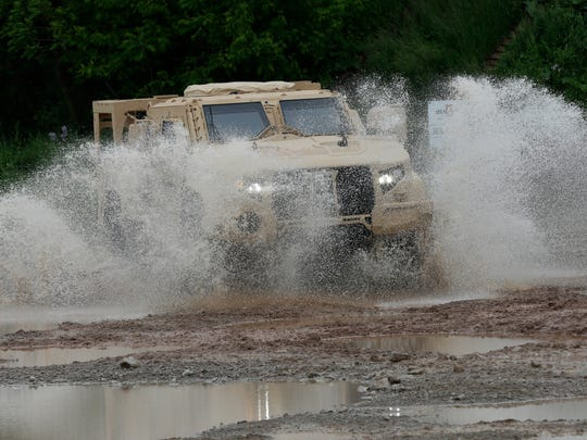 Oshkosh Corporation's JLTV maneuvers through the test course.  The JLTV is in the MATV family of vehicles only lighter and faster.  It possesses the same mine resistant and ambush protection as the MATV.  It is made by Oshkosh Defense.  May 24, 2017.Joe Sienkiewicz / USA TODAY NETWORK-Wisconsin