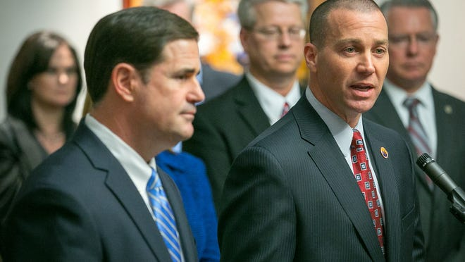 Gov. Doug Ducey (left) is refusing to release a whistle-blower complaint made against Greg McKay (right), who is now director of the Depart- ment of Child Safety. It was made by the department's general counsel when McKay led the agency's Office of Child Welfare Investigations.