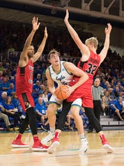 Ricky Doyle of FGCU tries to get around Taylor Bruninga (32) of Illinois State as Phile Fayne also defends during the game at FGCU Saturday afternoon, Nov. 11, 2017.