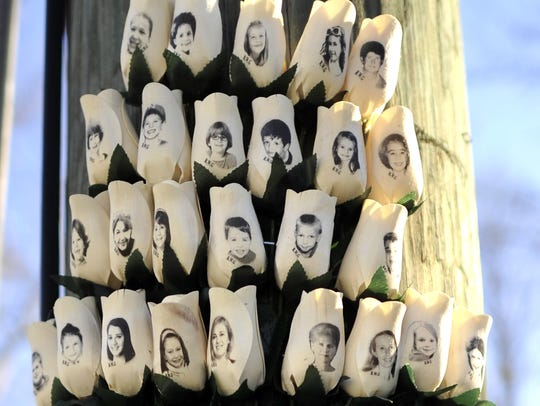 This file photo taken on Jan. 3, 2013 shows roses with the faces of Sandy Hook Elementary school victims in Newtown, Connecticut.