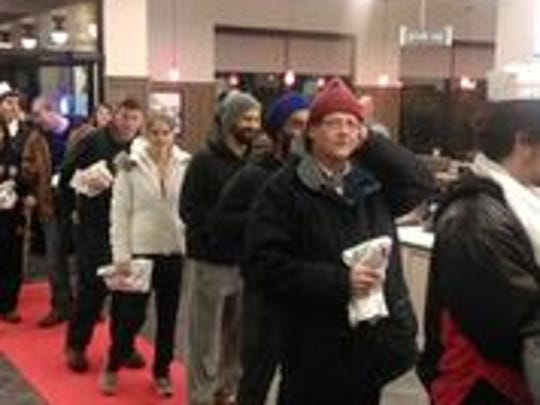 Customers await the chance for a year of free Chick-fil-A meals at the new location in Flemington that opened on Thursday.