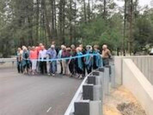 ribbon cutting at bridge