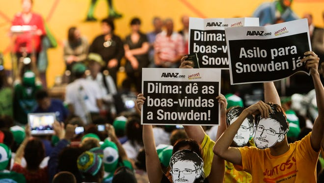 Protesters in Sao Paulo on Thursday want Brazil to grant political asylum to Edward Snowden, whose stay in Russia ends next summer.