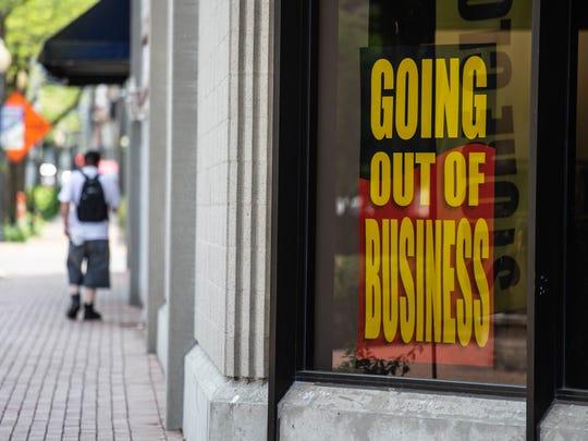 Closure signs are seen on the Elder-Beerman building,