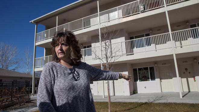 Jonna Sharpe, executive director of People Assisting the Homeless, on Tuesday provides a tour of PATH's apartments in Farmington.