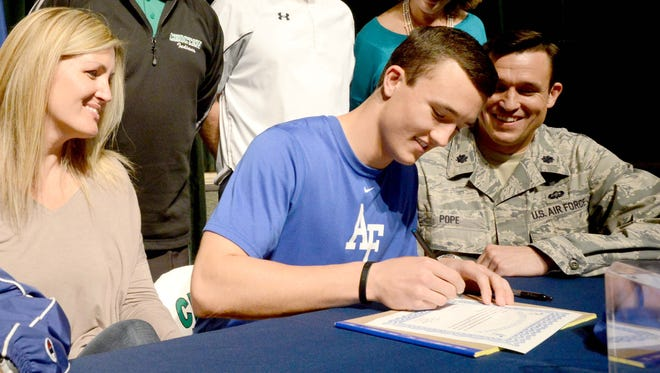 Players like Choctawhatchee High School (Fla.) senior Josh Pope, shown signing on Feb. 5, 2014, would have the chance to do so sooner if a recommendation is adopted by collegiate commissioners this summer.