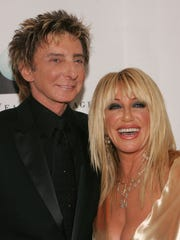 Barry Manilow, shown at the 2009 Steve Chase Humanitarian Awards with Suzanne Somers, says Somers would provide great entertainment at the Plaza Theatre, should she be allowed to purchase it.