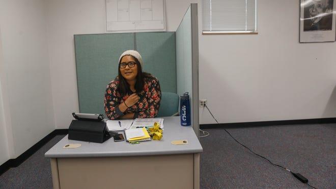 Chantelle John, Studio G's student marketing assistant, works at her desk Thursday in the San Juan College Quality Center for Business in Farmington.