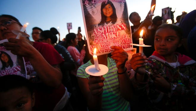 Community members hold a vigil for Ashlynne Mike on May 3, 2016, at the San Juan Chapter house.