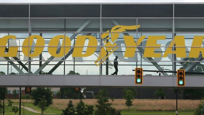 A man crosses the skywalk over Innovation Way at Goodyear Tire & Rubber Co. headquarters in Akron.