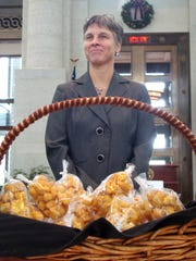 Liz Corzine, owner of Schlegel's Coffee House, stands by her winning caramel puffcorn in the Ohio Statehouse Atrium in Columbus in 2010.