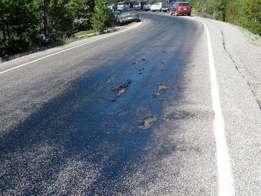 http://www.gannett-cdn.com/-mm-/0c5583d2e1b5772c0dd9cdad9c43e37a2f37ffd0/c=5-0-596-445&r=x404&c=534x401/local/-/media/WFMY/WFMY/2014/07/11/1405094314000-Yellowstone-NP-Road-Melts2-NPS.jpg