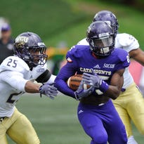 Former East Henderson High standout Steffon Hill (with ball) caught four passes for 80 yards in the Catamounts' Spring Game last week.