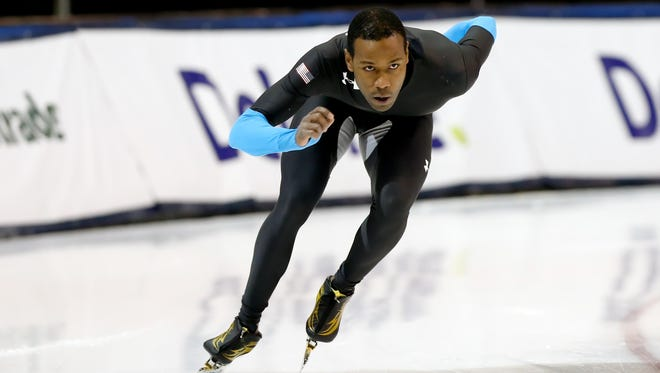Shani Davis warms up before competing in the 1000m during the U.S. Olympic speedskating trials Sunday. Davis won the event.