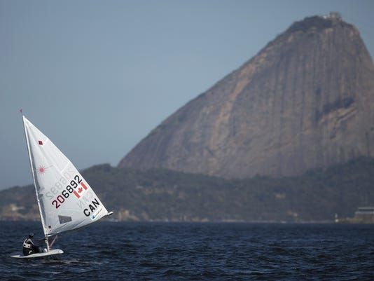 Canada's Isabella Bertold readies for a sailing test in the One Person Dinghy Women's Laser class event, ahead of the Rio 2016 Olympic Games, in Guanabara Bay in Rio de Janeiro, Brazil, Saturday, Aug. 15, 2015. (AP Photo/Leo Correa)