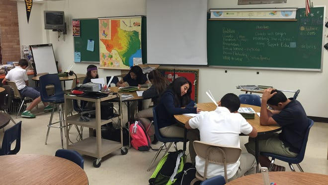 Seventh-grade students in a Lincoln Middle School journalism course practice news terminology.