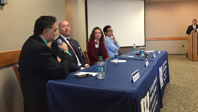 Doctors Shakil Karim, Kevin Ouweleen, Tiffany Owens and Even Wang answer questions during a panel Tuesday morning about what's new at Licking Memorial Hospital.