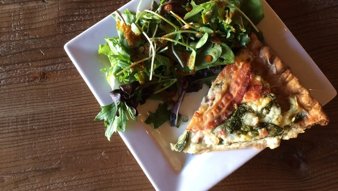Quiche is the best seller at Timshel Cafe in Neenah. The quiche don't get names, just a list of ingredients. This one was filled with bacon, white cheddar and spinach. Side salads come with house made dressings.