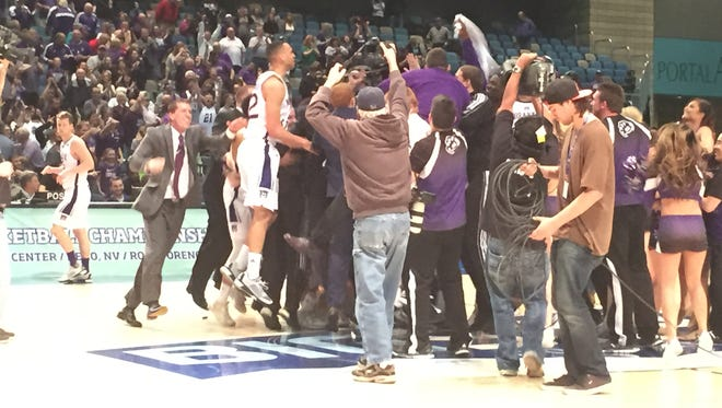 Weber State celebrates its 62-59 win over Montana in the Big Sky men's basketball championship on Saturday at the Reno Events Center.