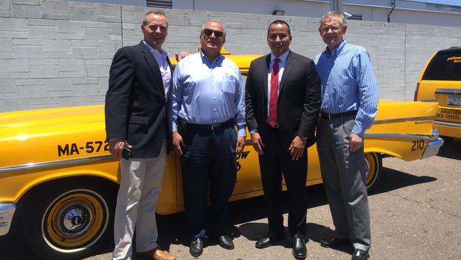 CASS spokesman David Smith (from left), Yellow Cab of Phoenix co-founder and general manager Joe DiBazar, Phoenix City Councilman Daniel Valenzuela and CASS CEO Mark Holleran mark Yellow Cab of Phoenix's donation of 20,000 bottles of water to the CASS Heat Relief Effort water drive on June 14, 2016.