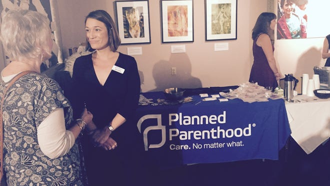 State Rep. Susan Fisher, D-Buncombe, speaks with Nikki Harris, director of philanthropy in Western North Carolina for Planned Parenthood South Atlantic Monday night at the aSHEville Museum in downtown Asheville. Planned Parenthood marked its centennial anniversary this year with 650 clinics around the country dedicated to making reproductive health care accessible to all.