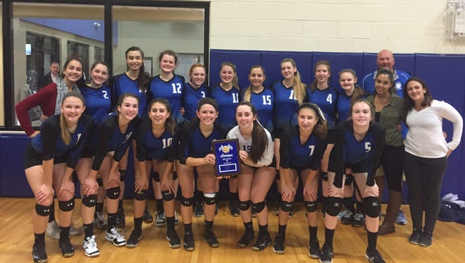 Millbrook High School's volleyball team poses after winning the Section 9 Class C title on Sunday.