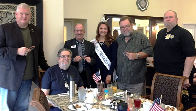 State Rep. Paul Evans, far left, and Salem Area Chamber of Commerce CEO Dan Clem, third from left, are among the dignitaries who attend the Veterans Day celebration Friday, Nov. 11, 2016, at Prestige Senior Living Orchard Heights in Salem.