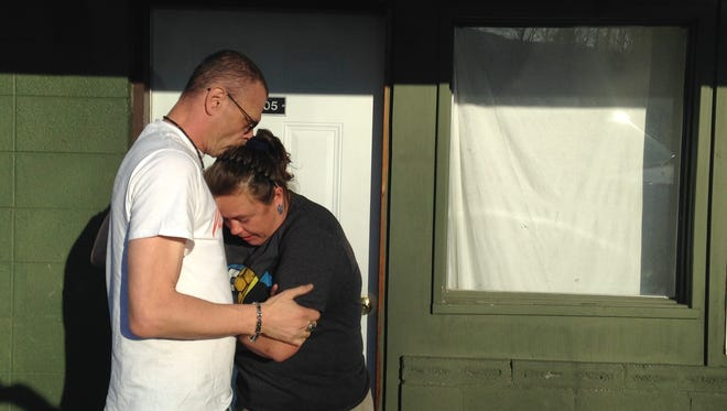 Charlie Britton and Jasmine Hurst embrace in front of his apartment at the Rainbow Motel in Gatlinburg on Friday, Dec. 2, the first day residents were allowed back into the city after Gatlinburg went into flames Monday night.