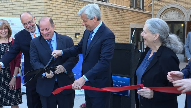 Mayor Mike Duggan is joined by JPMorgan Chase CEO Jamie Dimon (center) and Midtown Detroit Inc.'s Sue Mosey (right) at the September 17, 2015 ribbon-cutting at the Rainer Court apartments project in Midtown Detroit.