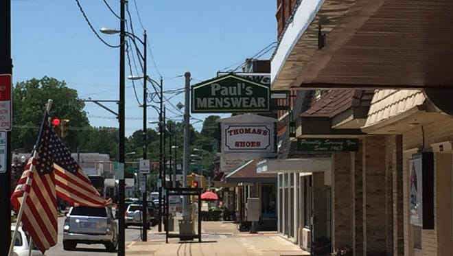 Business owners along West Franklin Street are urging the city to take a look at parking issues along the busy corridor.