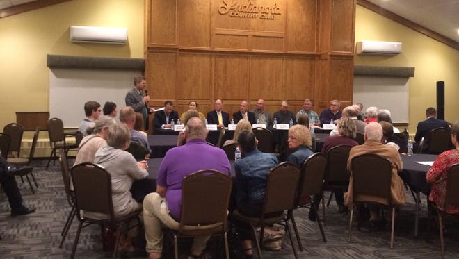 Nine candidates who are running for spots on the Indianola City Council answered questions during a forum at the Indianola Country Club Oct. 17.