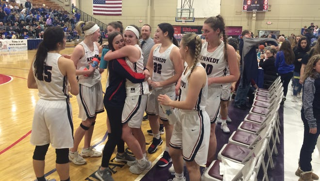 Kennedy's girls basketball team celebrates beating Faith Bible on Friday in the state semifinals.