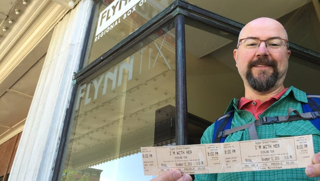 Matt Saltus of Burlington holds his I'm With Her tickets outside the Flynn Center on June 8, 2018.