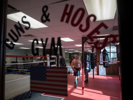The Hoses team works out during a practice session at the Guns and Hoses Gym in Old Vanderburgh County Courthouse on Friday, March 30, 2018. The Guns and Hoses event pits law enforcement officers against firefighters in night of charity boxing matches on April 7.