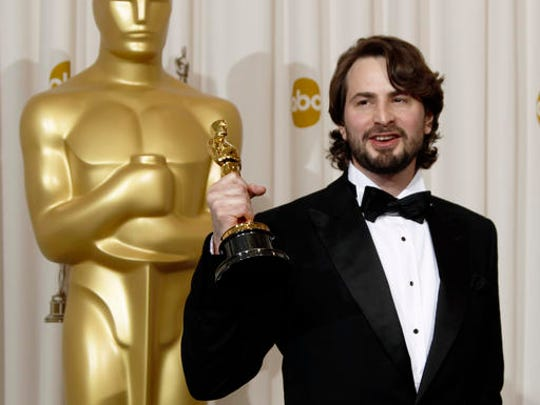 """FILE - In this March 7, 2010, file photo, Mark Boal poses backstage with the Oscar for best original screenplay for """"The Hurt Locker"""" at the 82nd Academy Awards in the Hollywood section of Los Angeles. A lawyer for an Oscar-winning screenwriter says the U.S. Army dropped its efforts to seize unaired interviews he recorded with Sgt. Bowe Bergdahl. Attorney Jean-Paul Jassy said Tuesday, Dec. 13, 2016, that Boal settled a lawsuit to prevent the government from obtaining 25 hours of recordings with the soldier who abandoned his post in Afghanistan in 2009. (AP Photo/Matt Sayles, File)"""