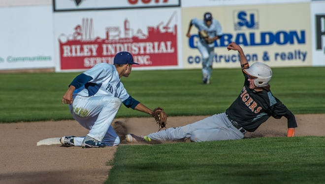Aztec's Zach Taylor gets caught trying to steal second base against Piedra Vista on April 28 at Ricketts Park.