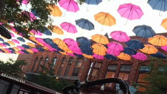 Early morning light brightens the umbrellas hanging over Third Street in downtown Wausau.