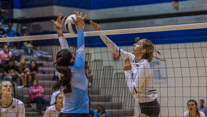 PV's Bebe Jaquez, right, records a kill against Ganado, Ariz., during the championship match of the Piedra Vista Invitational on Sept. 10 at the Jerry A. Conner Fieldhouse in Farmington.