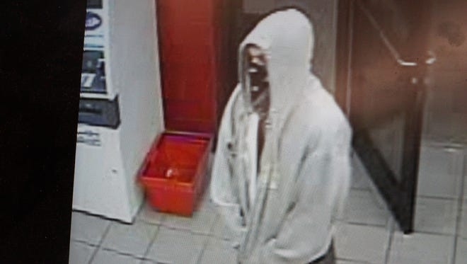 Nixa police are searching for a man suspected of firing a gun inside a convenience store Wednesday.
