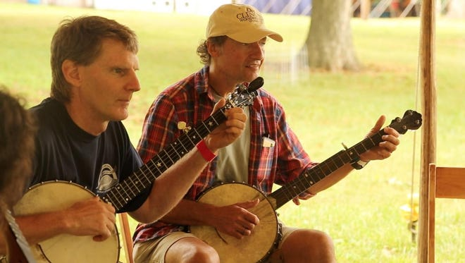 Students in Mac Benford?s advanced clawhammer banjo class pick away at the Grassroots Culture Camp last year.